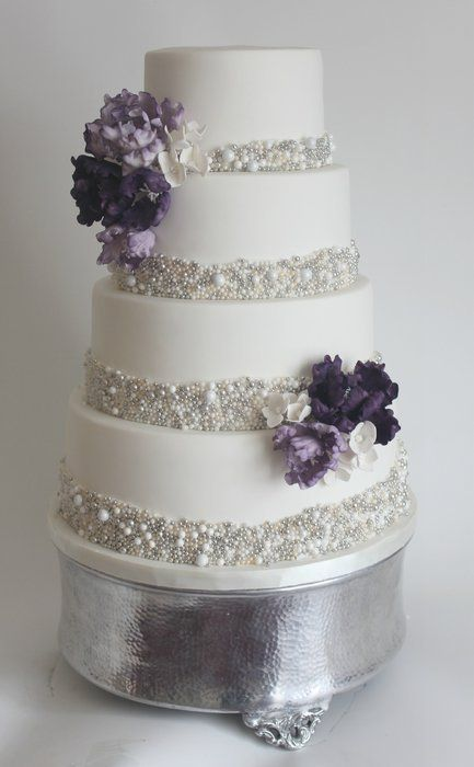 Sparkling Glitter Wedding Cake In White And Silver With Violet Flowers