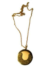Hmm really like this, especially if its a locket.