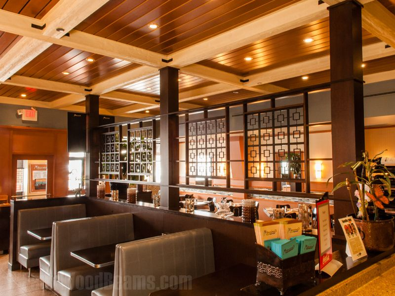 A striking ceiling design made with our sandblasted faux wood beams. The  location is Mannino's