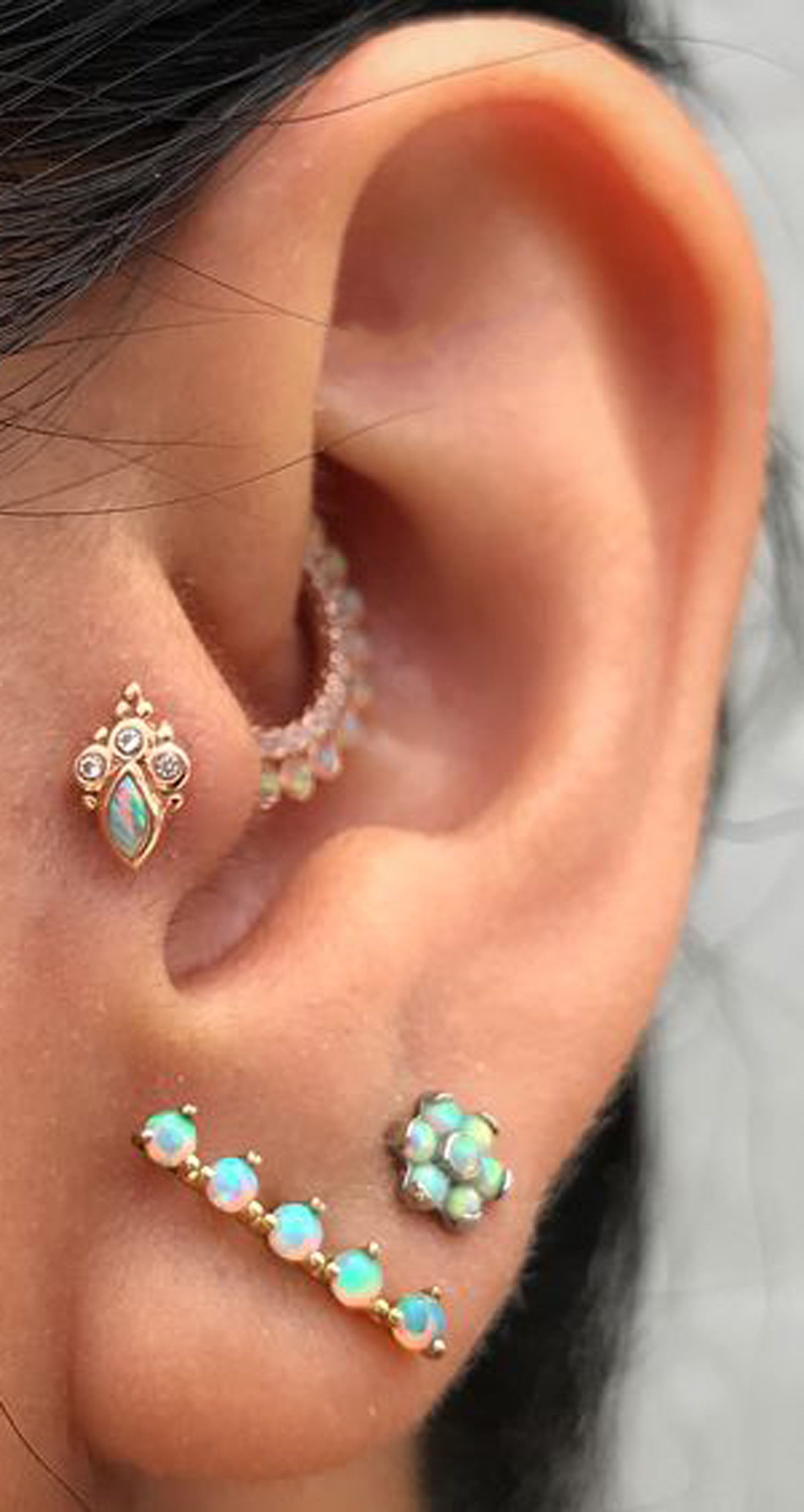 opal multiple ear piercing ideas for women  cute opal ear piercing ideas for women for tragus daith ear lobe