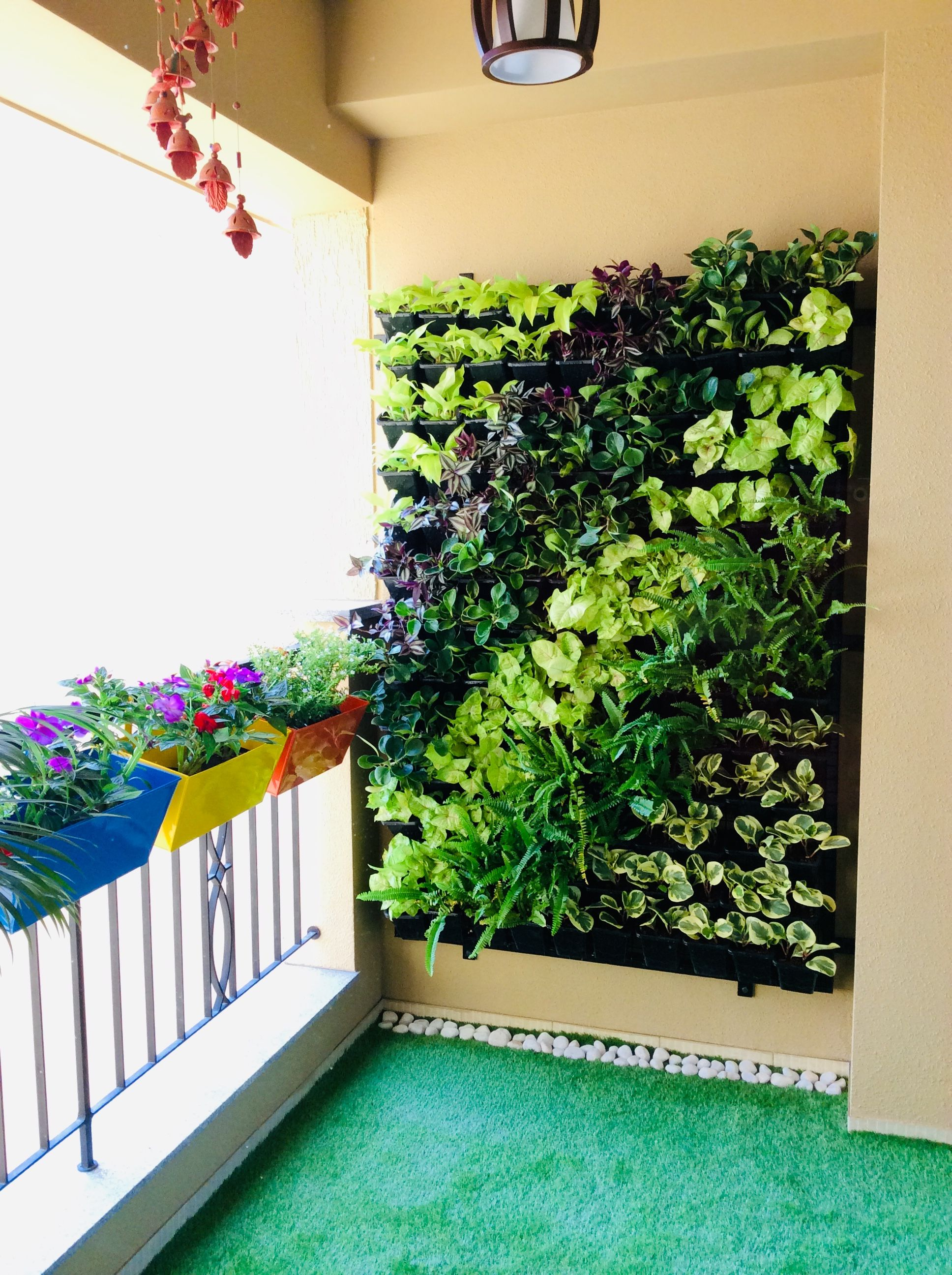 Green wall/Vertical Garden design done using many indoor