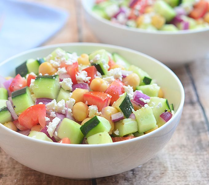 Cucumber Tomato and Feta Salad- a delicious salad made with crisp cucumbers, plump tomatoes, garbanzo beans with a tangy red wine vinaigrette