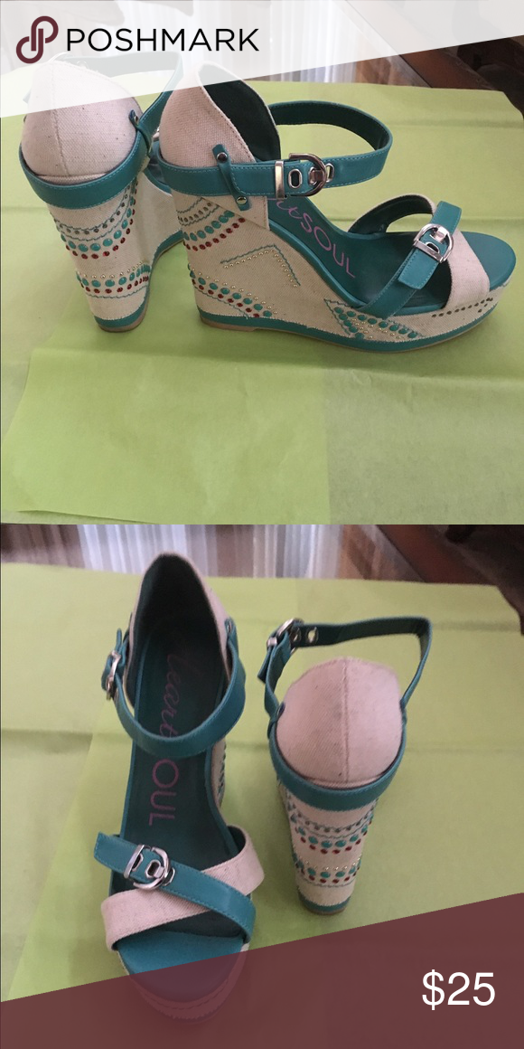 heartsoul heels These heels are very unique and they are a turquoise and tan color. Along the bottom of the heal are semi circle designs in those colors as well. Worn twice minor rough spots. HeartSoul Shoes Heels
