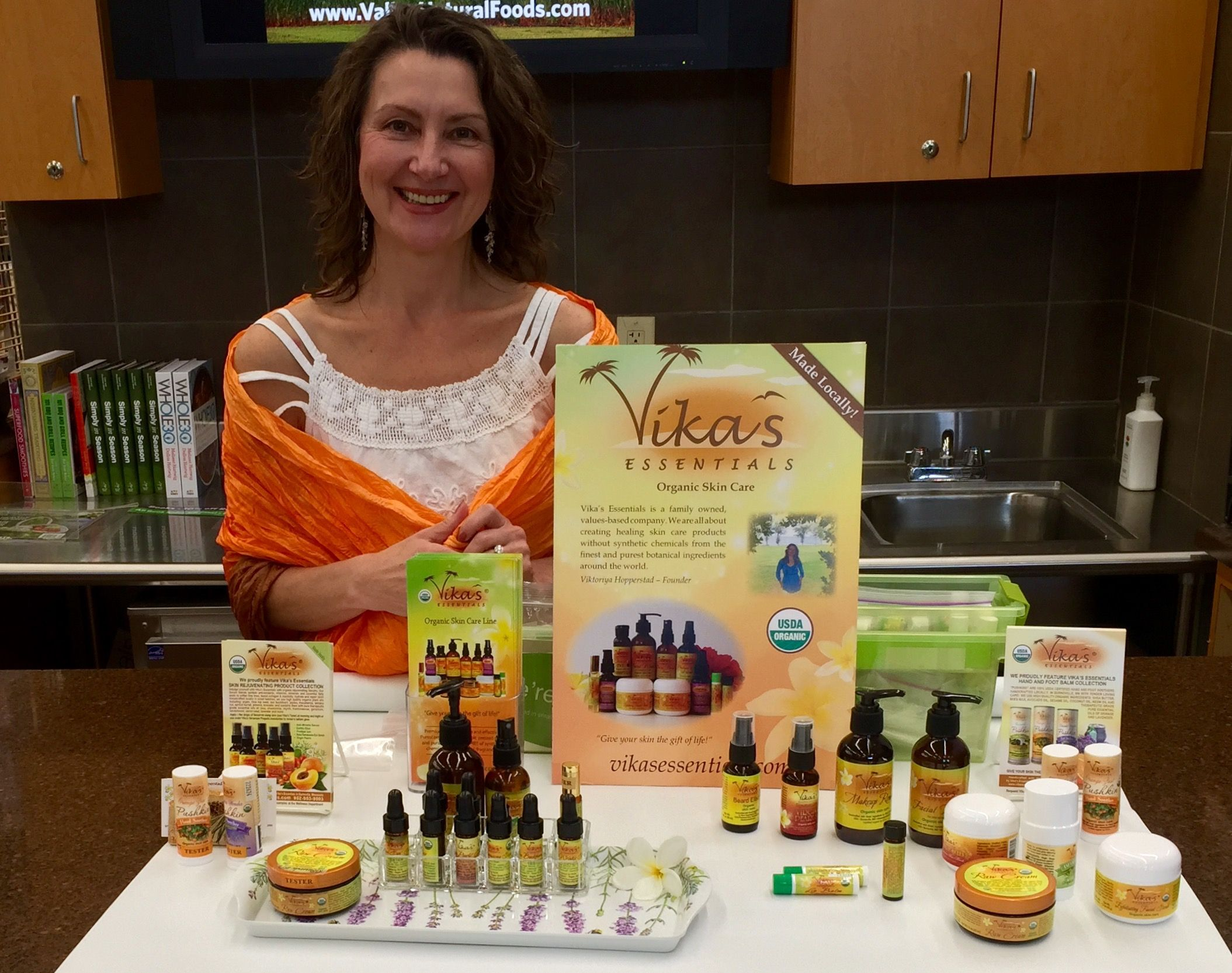 Vika at Valley Natural Foods coop offering customers a