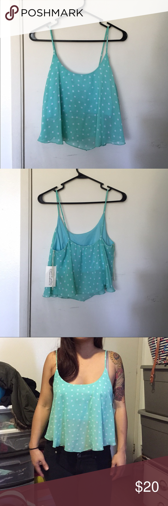 New mint and white polka dotted crop top NWT mint and white polka dotted crop top, size large but fits like a medium. Straps are not adjustable. Material: 100% polyester Tops Crop Tops