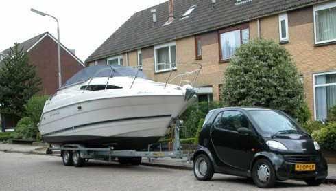 Smart Car Pulling A Boat