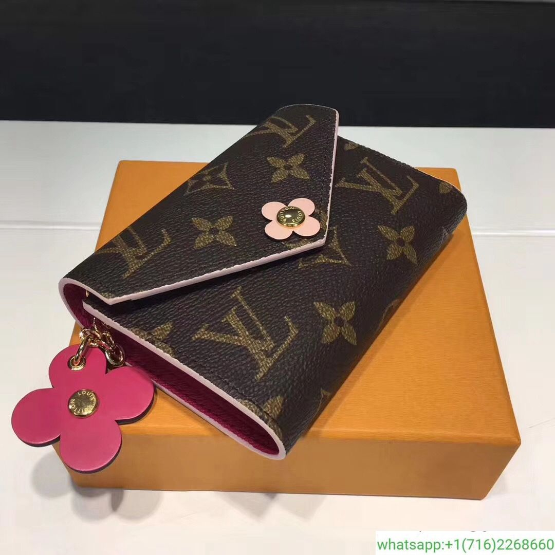b83743bbb9ef Louis Vuitton Monogram Canvas Victorine Wallet With Flower Charm M64203