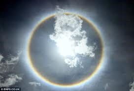 16. Sun Dogs   Sun dogs are an atmospheric phenomenon that occur when ice        crystals cause light to appear brighter when the sun is at a certain        angle
