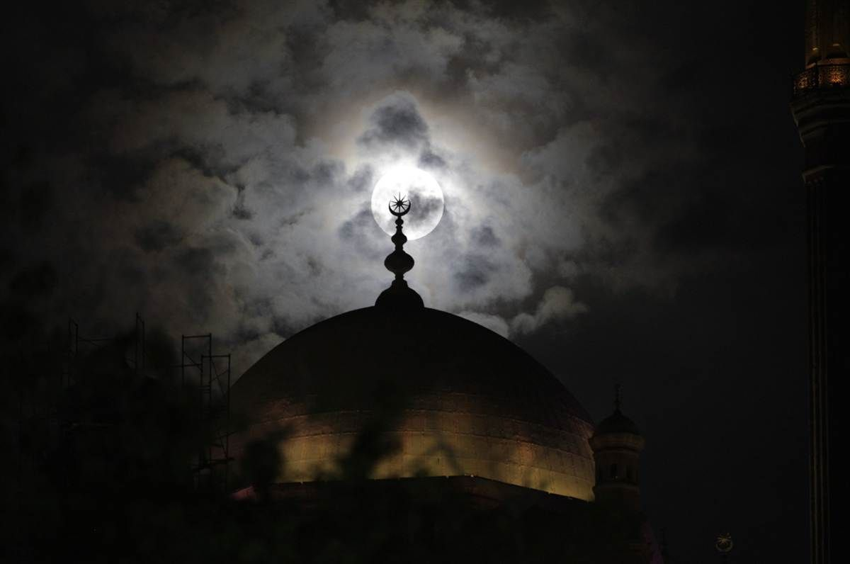 Supermoon seen behind the minaret of the Mohamed Ali Mosque in Cairo, Egypt
