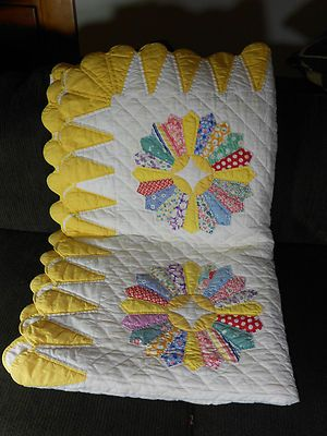Dresden plate design which came out in 1920s. Fabrics of this cotton quilt are from 1930s and 1940s. 90 in x 70 in.  Awwesome draped in sunny country kitchen or family room!!