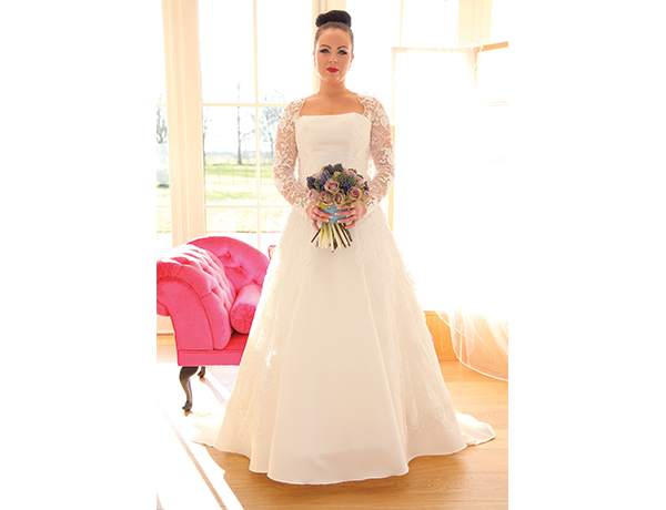 Burghley. A Stunning Satin Princess Line Gown With