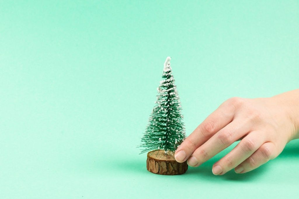 Small Christmas Tree In Woman Hand On A Green Advertisement Sponsored Ad Tree Green Hand Chri In 2020 Small Christmas Trees Stud Earrings Christmas Tree