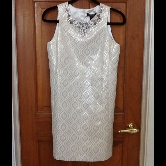 WhiteHouse BlackMarket dress, NWT$200, classy, 4P This gorgeous dress is made of a jacquard fabric that has glimmers of silver and gold without over the top!  The neckline features a design of clear gemstones and white beads.  The dress has a hidden back zipper and is fully lined in an ivory satin.  Very classy looking! White House Black Market Dresses