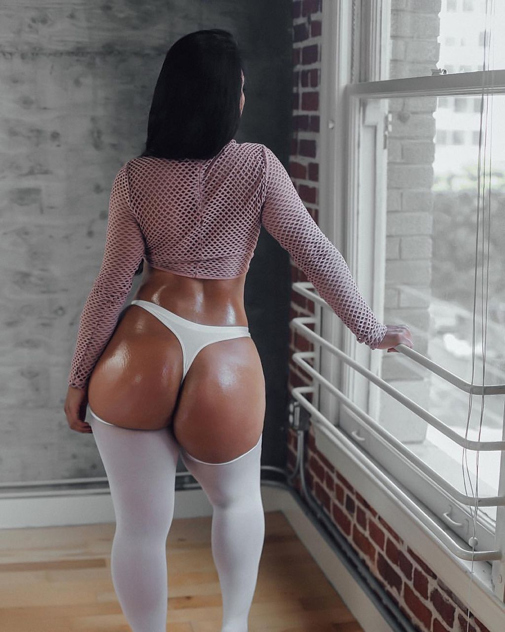 Tight black skirt bent over