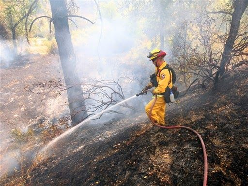 Firefighter killed as wildfires rage across West