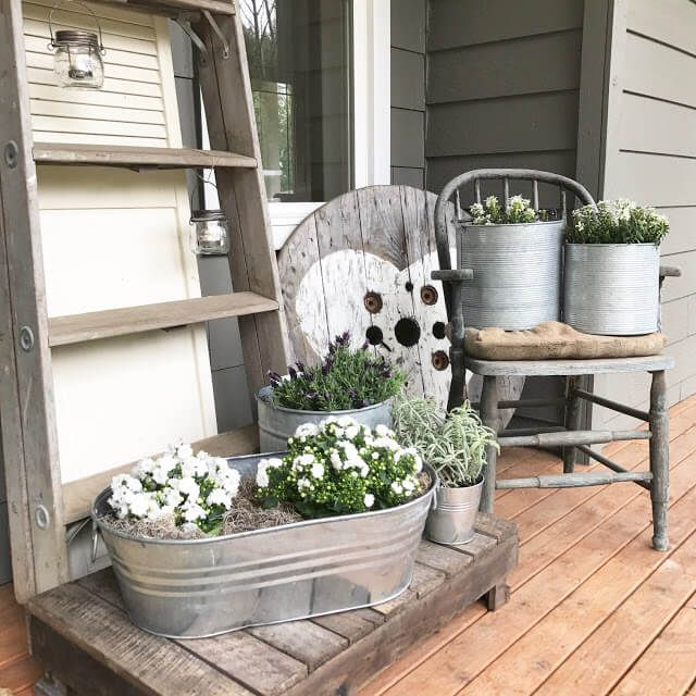 Farmhouse Front Porch Ideas: Metal Washtub With White And Greenery Arrangements