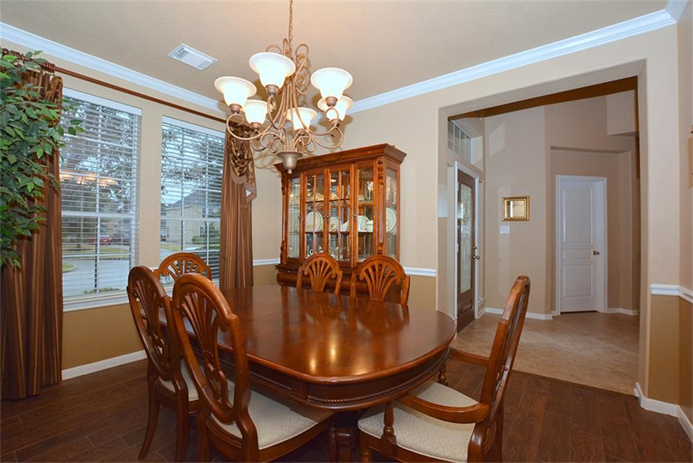 The Elegant Formal Dining Room Is Located Off Entry And Features A Chandelier Crown
