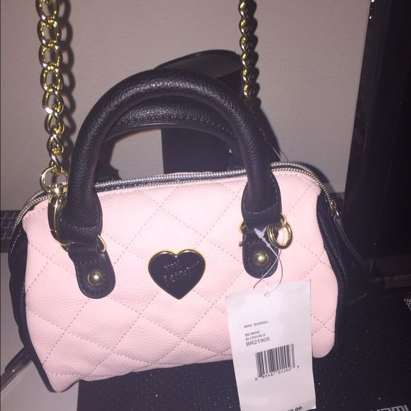 Betsey Johnson diamond quilted mini barrel purse Blush pink & black cute mine purse. Diamond quilted look. Leather like feel. Gold accents. Long strap, so yes it can be worn cross body. Rally cute and convenient. Make me offers  Betsey Johnson Bags Mini Bags