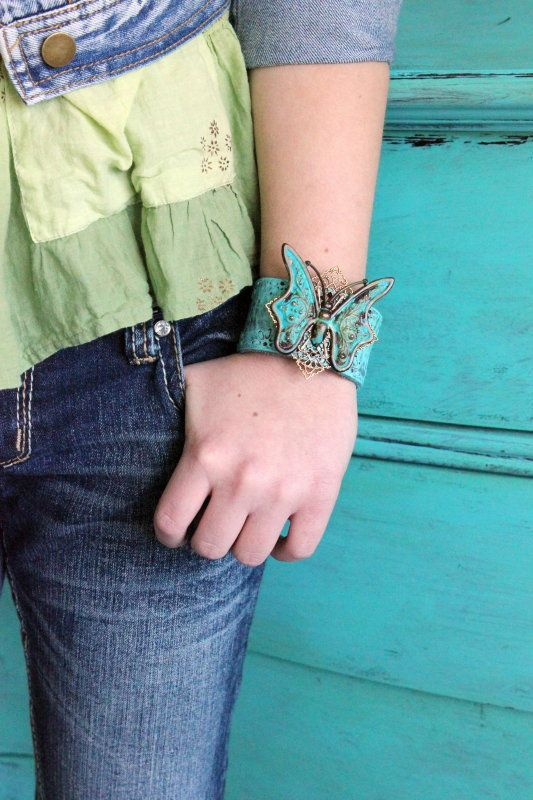 Turquoise Butterfly Leather Cuff ~ Made with an upcycled genuine leather belt and a brass butterfly aged with a verdigris patina. Very boho chic! www.ever-designs.com