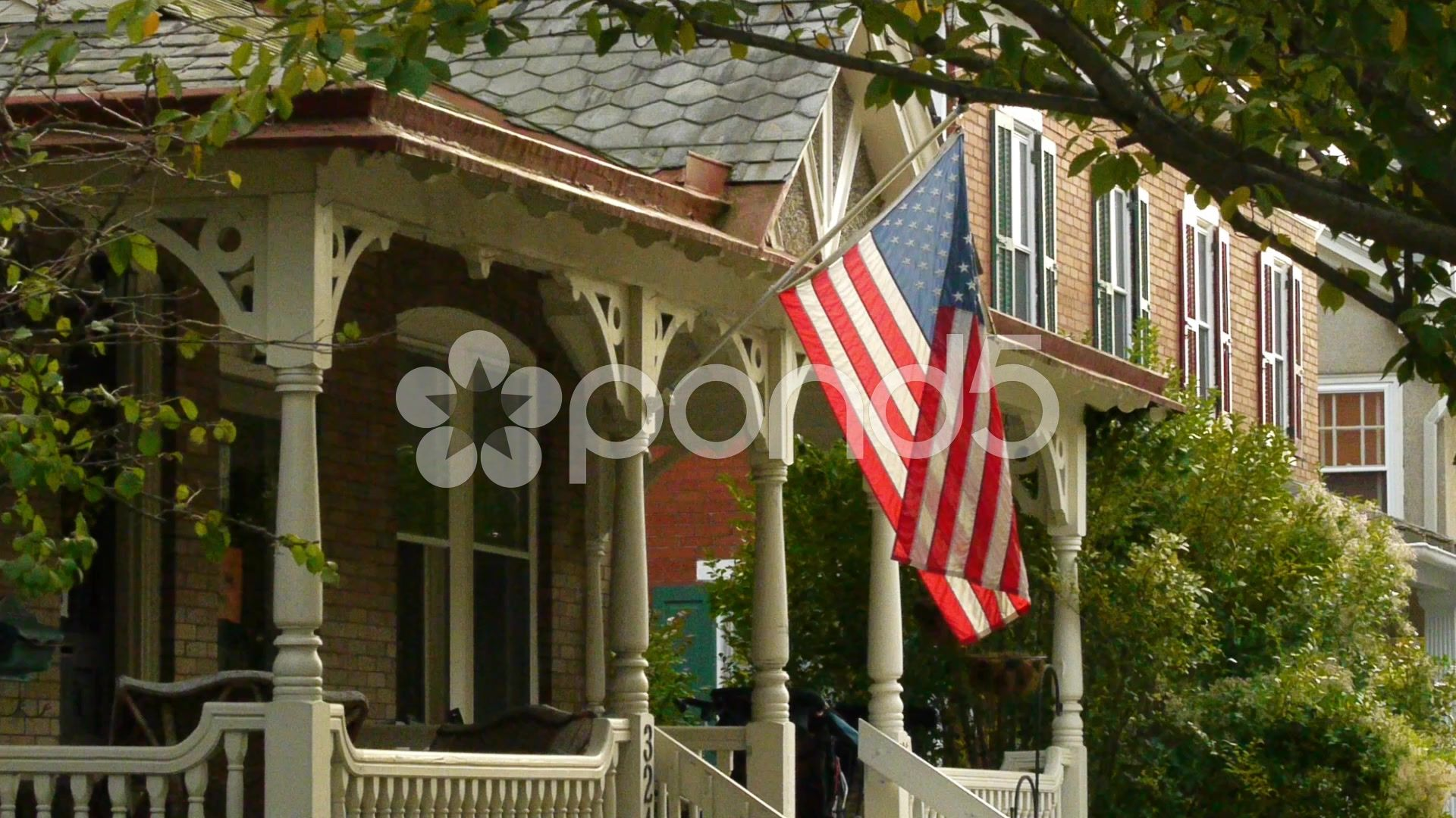 American house golden hour flag 2 of 2 Stock Footage goldenhouseAmericanhour