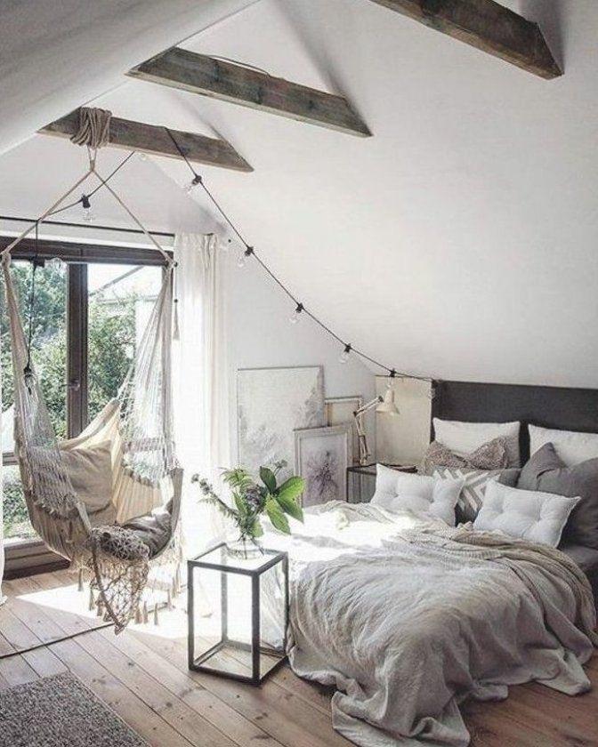 chambre a coucher sous les combles  sol en bois clair  chaise bercante  grandes fenetre vers le balcon #homedecor #home #roomideas #ideas #trendsdecor #decoration #design