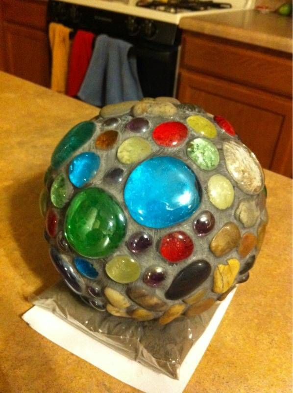 foam ball core. flat bottom glass pieces. e6000 glue. black grout. can go outside--way cool