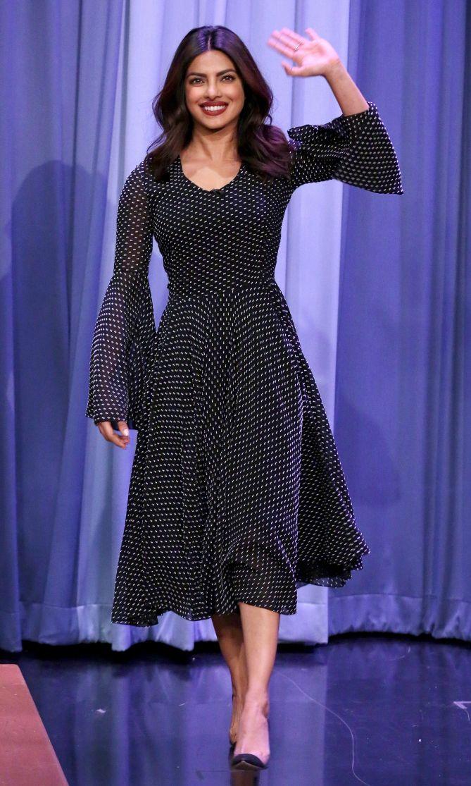 0ce08177e3 Priyanka Chopra in a black polka-dot bell-sleeve midi dress