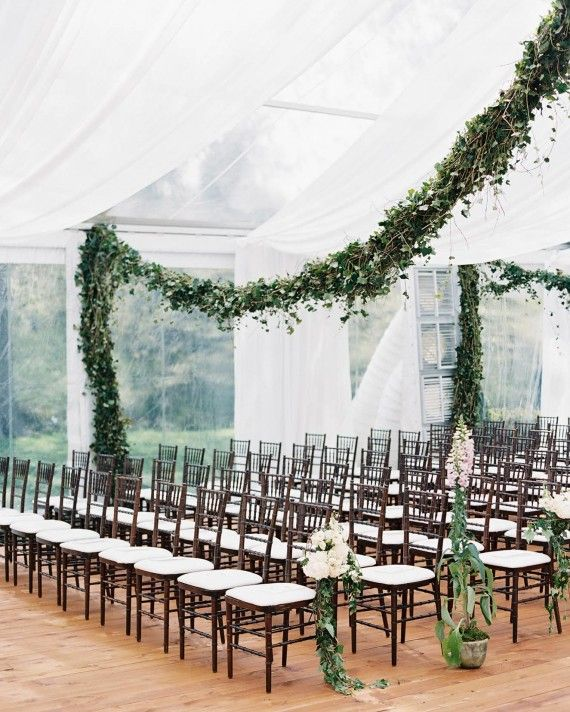 Situated on the Edsel and Eleanor Ford House property facing Lake St. Clair, the couple wed surrounded by friends, family, and flowers. Garlands of ivy hung from the ceiling of the ceremony tent while pots of foxglove lined the aisle, giving the illusion of a beautifully-filled greenhouse.