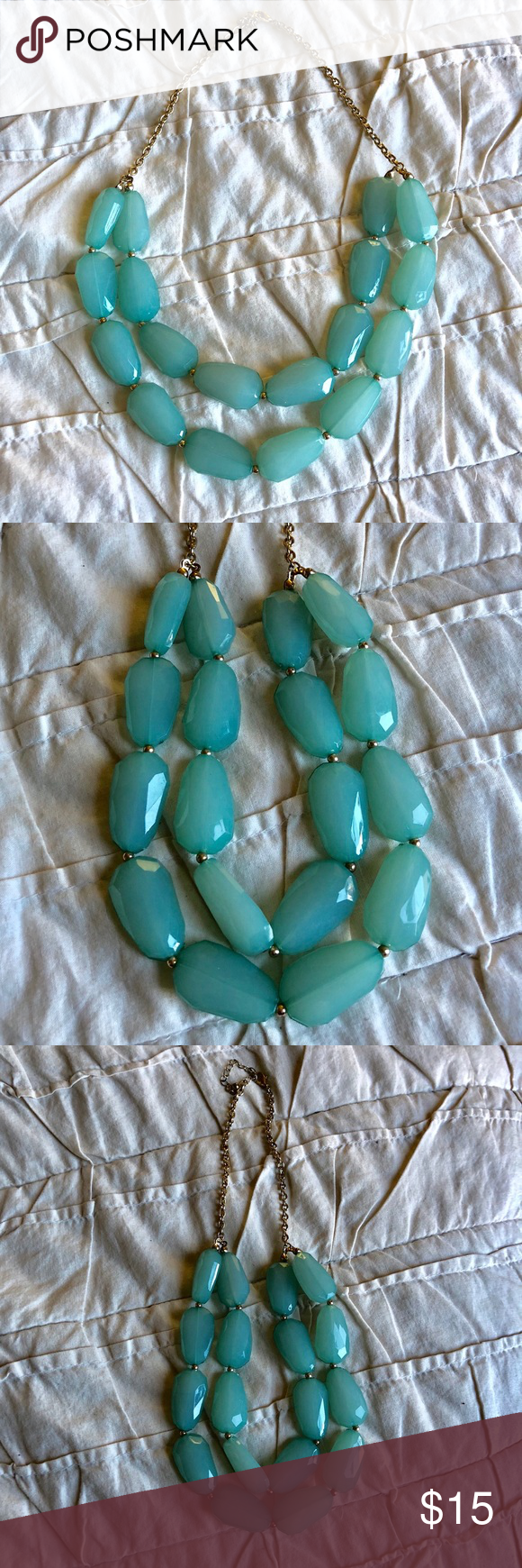 Jade color beaded necklace From the top of the chain to the bottom of the second string of beads the distance is 10inches. The beads are a lovely jade color. They are made of plastic Jewelry Necklaces