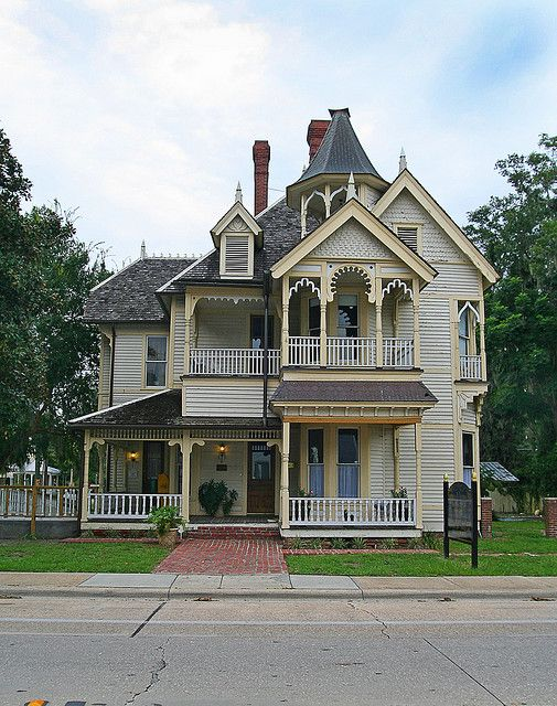 Queen Anne Victorian Home with two and a half stories, frame, complex grouping of porch, balconies, and a hexagonal turret. c. 1894