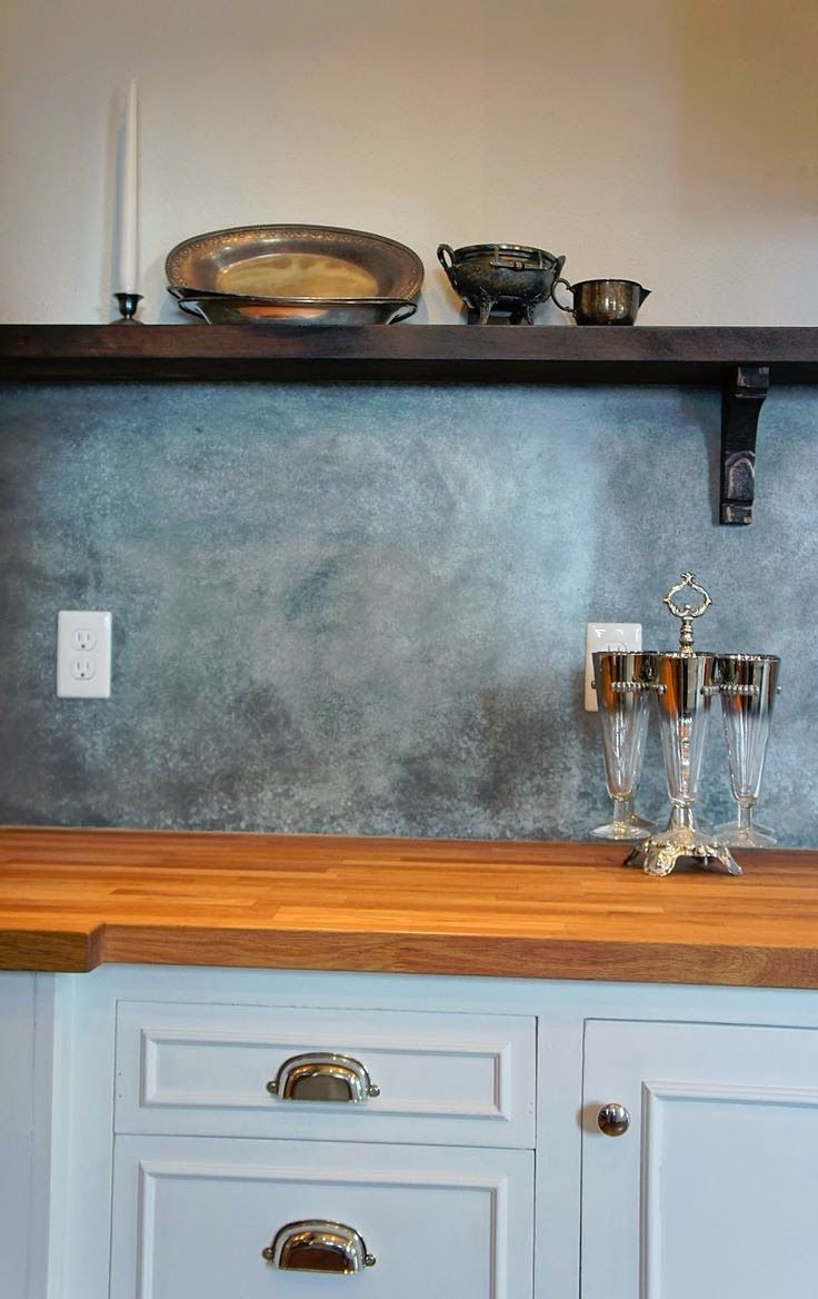 instead of tile have a backsplash of galvanized fit your space