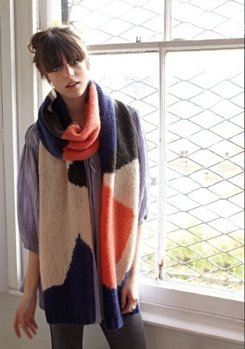 Love the shape and drape of this scarf; the asymmetrical pattern maybe not so much...but maybe it would grow on me. Anyway, a clear inspiration for knitting.