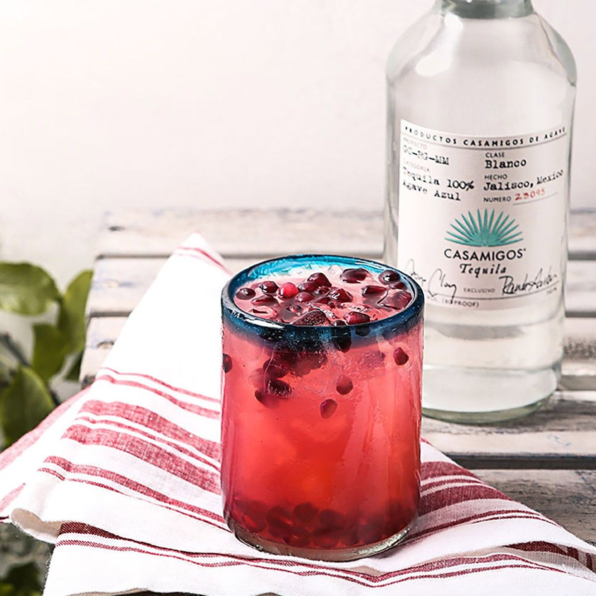 CASA SALUD 1.5 oz. Casamigos Blanco Tequila .5 oz. Fresh Lime Juice .5 oz. Cane Sugar 2 Thin Slices Serrano Chili 2 Bar Spoons Pomegranate Seeds Muddle pomegranate seeds in the bottom of shaker. Add all remaining ingredients. Shake vigorously for 8-10 seconds. Fine strain into rocks glass. Add ice. Garnish with 5-6 pomegranate seeds.
