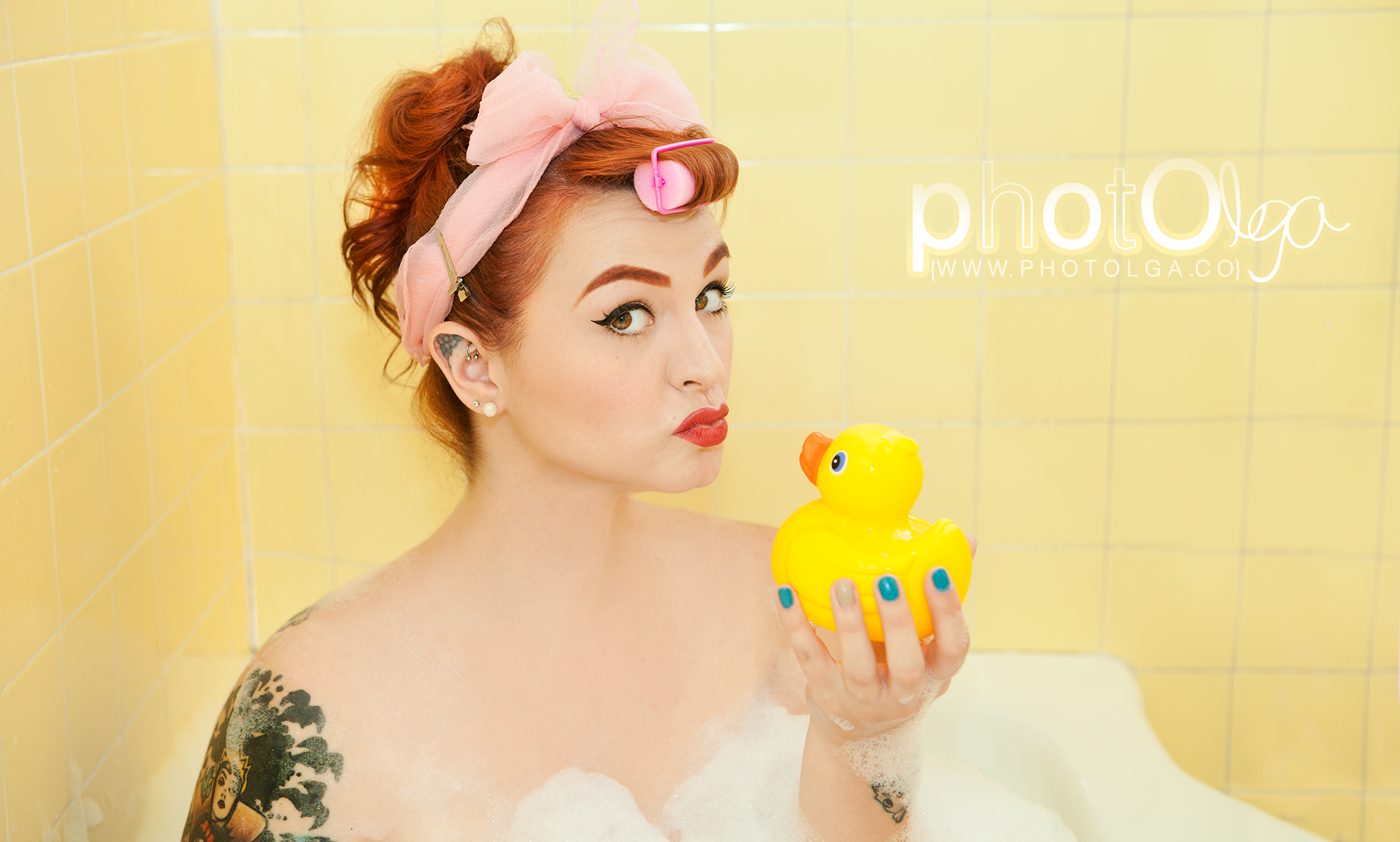 red haired mary ann jones enjoying a bubble bath in a retro pinup style
