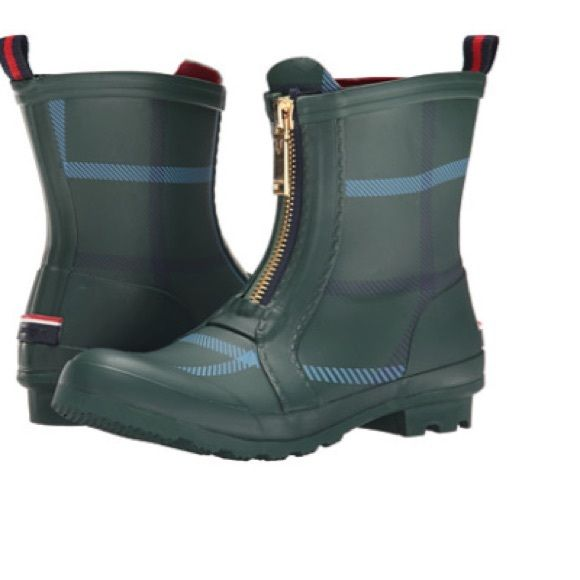 Tommy Hilfiger Green Plaid rain boots Plaid-printed rubber upper. Pull-on construction with front zipper. Shiny gold-tone hardware adds an elevated look. Warm textile lining and insole. Rubber outsole.  Measurements: Heel Height: 1 in Weight: 1 lb 12 oz Circumference: 13 in Shaft: 6 3⁄4 in Product measurements were taken using size 8, width M. Please note that measurements may vary Tommy Hilfiger Shoes Winter & Rain Boots