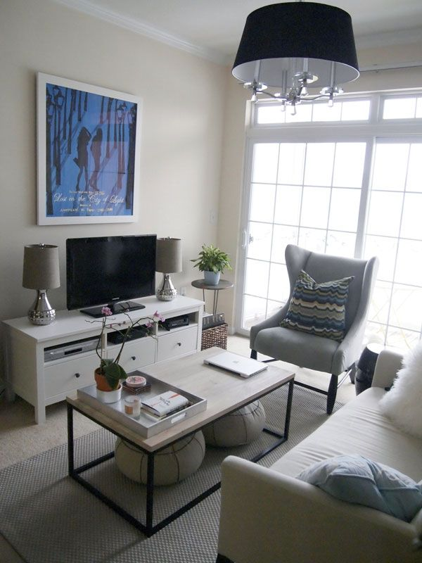 decor ideas for small living room small apartment living room interior design I like the seats under the coffee table, the wing chair and the sliding  glass door