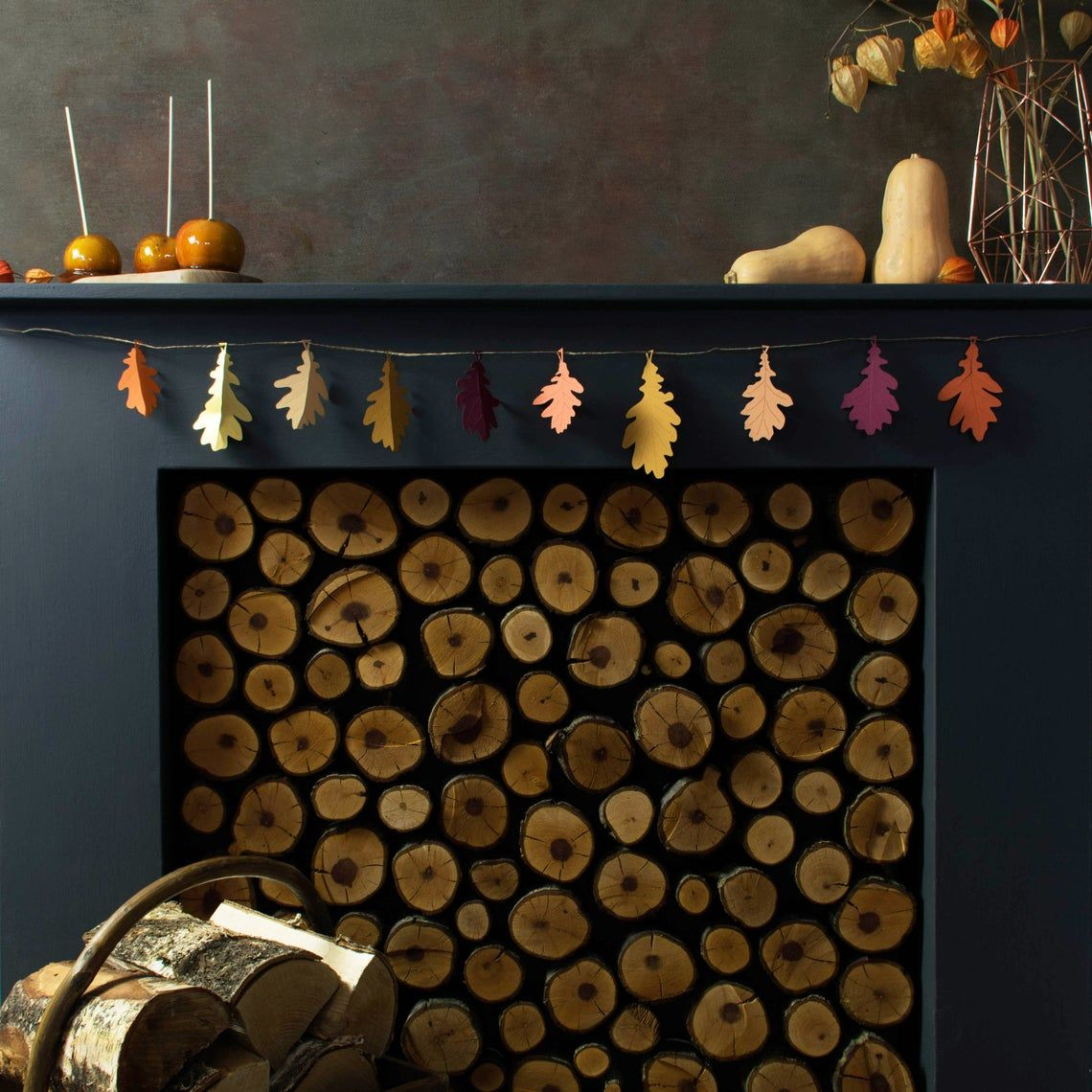 How are you decorating your mantel for the season? This fall motif lasercut paper garland makes an easy and festive addition.