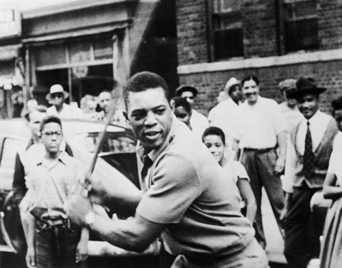 429327e1be054b ... the African American community. That popularity was famously captured  as he played stick ball ...