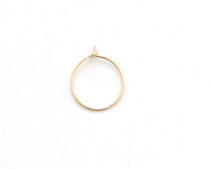 FINALLY-- a thin GOLD nose ring hoop!!  If youre one that has a nose piercing, then you know that QUALITY thin nose ring hoops are HARD TO FIND. So, I took it upon myself to make my own. Not only is it extremely thin and dainty, but it adds that delicate, feminine edge to any face. This is why k o o d e l a h gold nose rings have been a huge success! Each thin nose ring is carefully hand forged to order in our home studio. Ends will be filed and sanded smooth. Hoop will be cleaned and…