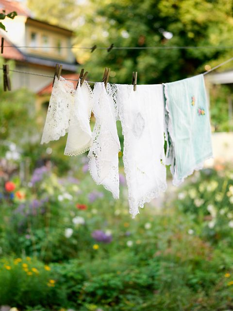A Garden in Sweden with vintage hankies on the clothesline drying in the sun and fresh air.