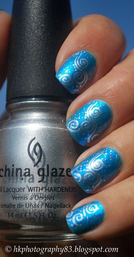 Stamping nail art #HKphotography China glaze silver polish used for swirls on pretty blue nails. #fallnails - bellashoot.com