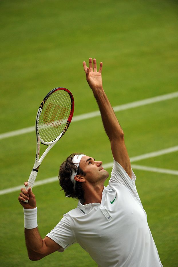Roger Federer eyes his toss during his second round match against Fabio Fognini. - Tom Lovelock/AELTC