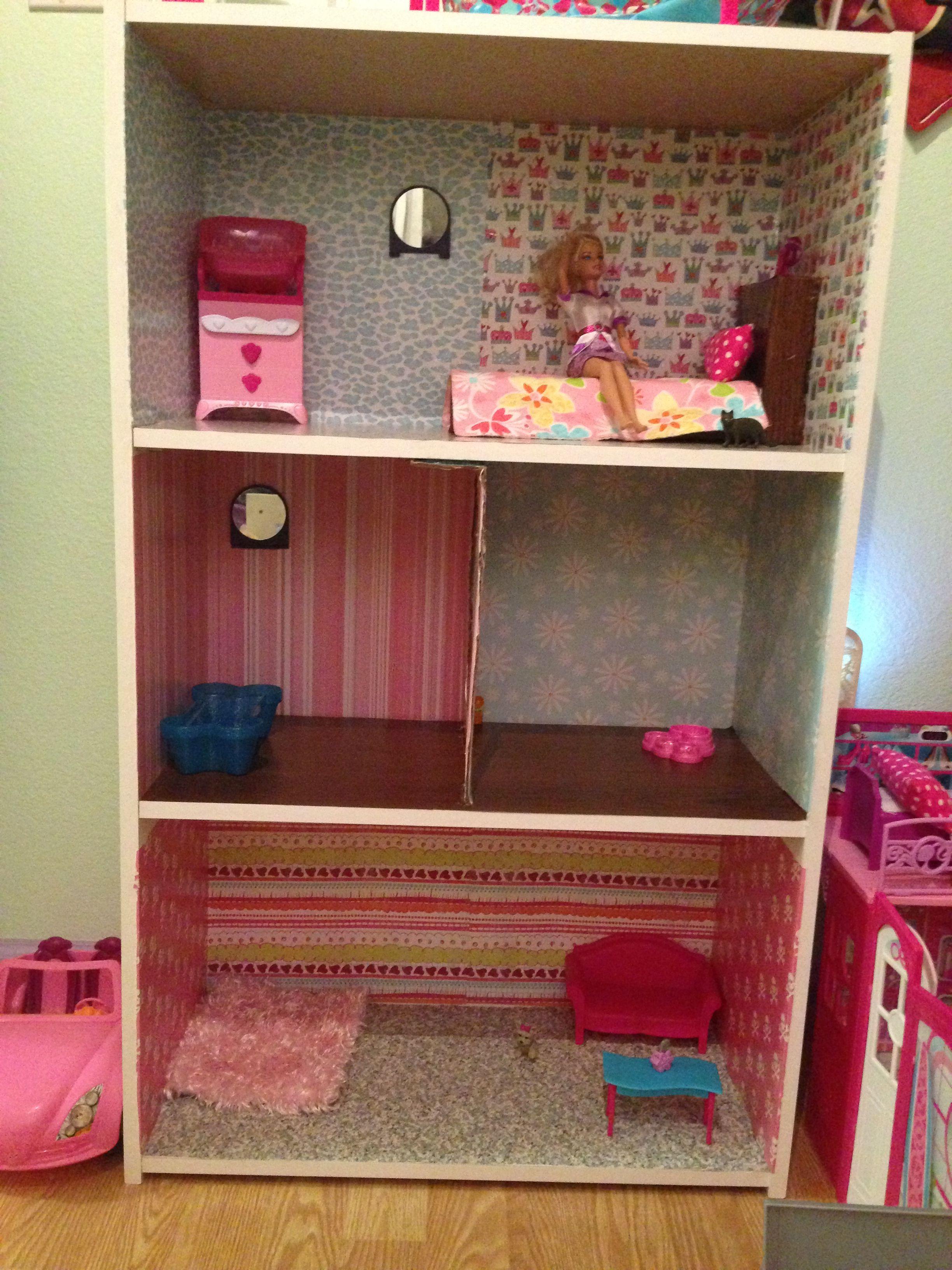 DIY Barbie House. Bookshelf (Target), scrapbook paper/mod