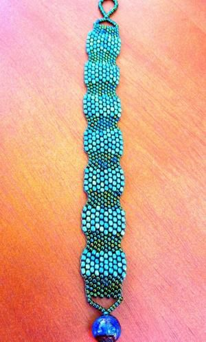 Handstitched Peyote Beaded Bracelet with Color Changing Clasp. $35.00, via Etsy.  Stitched with two shapes of beads. by Shopway2much