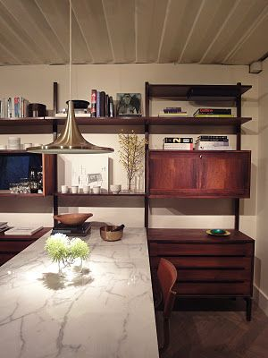 add a piece of marble to bookcase forming a custom deskstorage combination