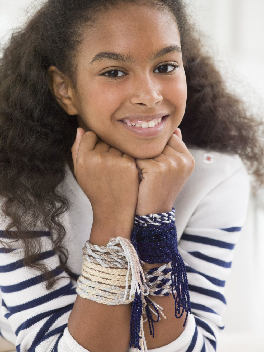 Make these free spirit bracelets with kids for a fun afternoon project! Free pattern calls for Vanna's Glamour (pictured in platinum, topaz, sapphire, and moonstone), but you can use leftover skeins and make this a stas-hbuster project too!