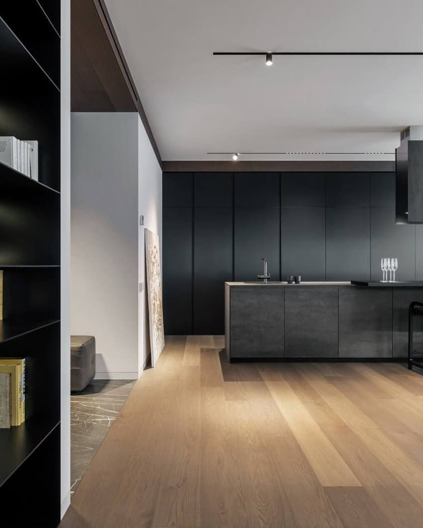 The Material Palette Of The Apartment Is A Juxtaposition Of Muted
