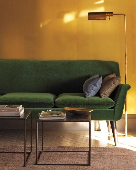 A Wall Clad In Sheets Of Unlacquered Untreated Br Laminate Adds High Drama To Living Room Complement The Forest Green Sofa And Accents