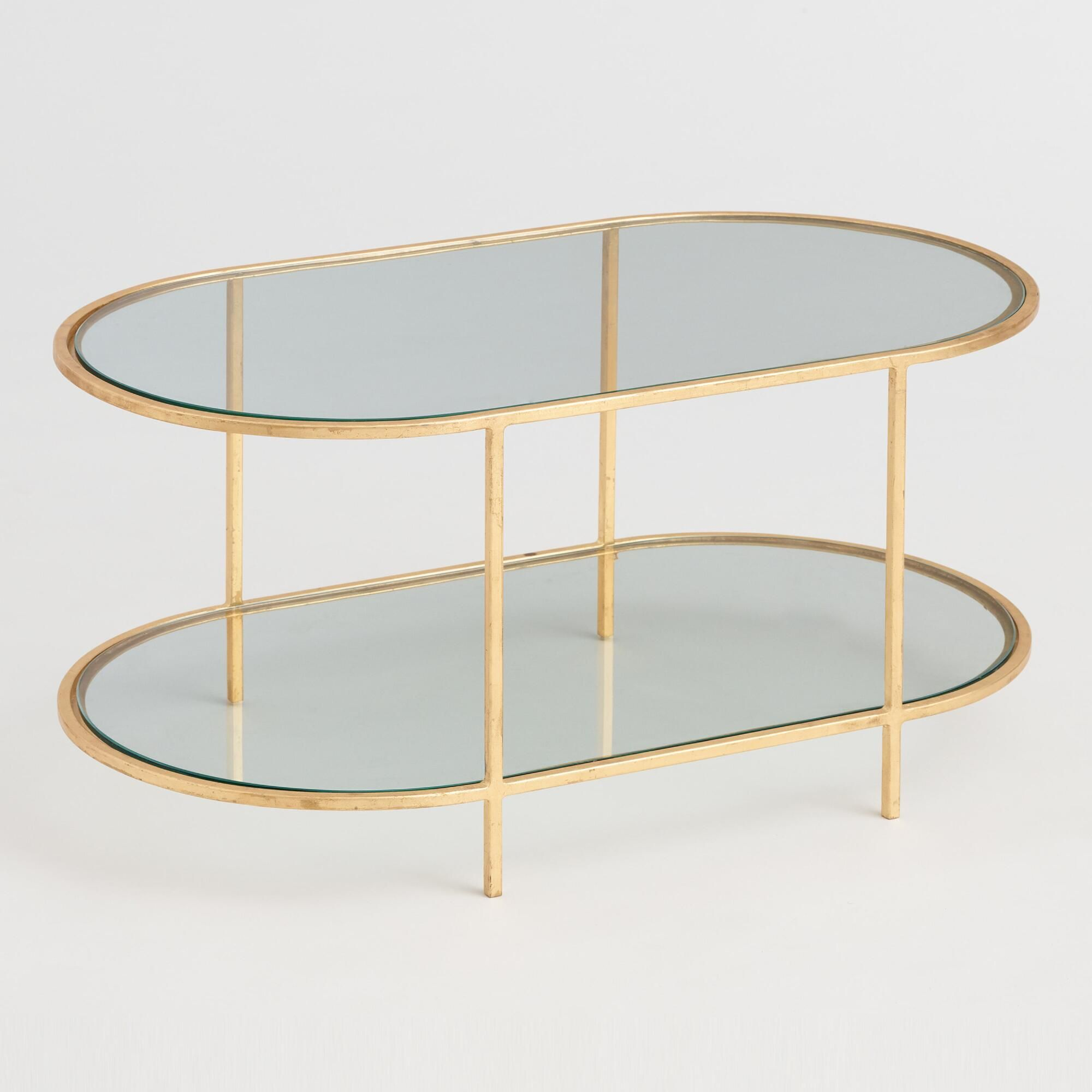 Oval Glass and Gold Leaf Rosalyn Coffee Table by World Market is part of Living Room Shelves Gold - Furniture Inspired by the beauty of goldleaf detailing, we designed our Rosalyn tables with handapplied, hammered goldtoned metal  A glass tabletop and low shelf give this coffee table luxe looks and extra storage, making it a modern musthave  Material , Color  Also could be used forcoffee table,table,side table,cocktail table,accent table,occasional table,ottoman,console table,home decor,family room furniture,home furnishings  By Cost Plus World Market 565766