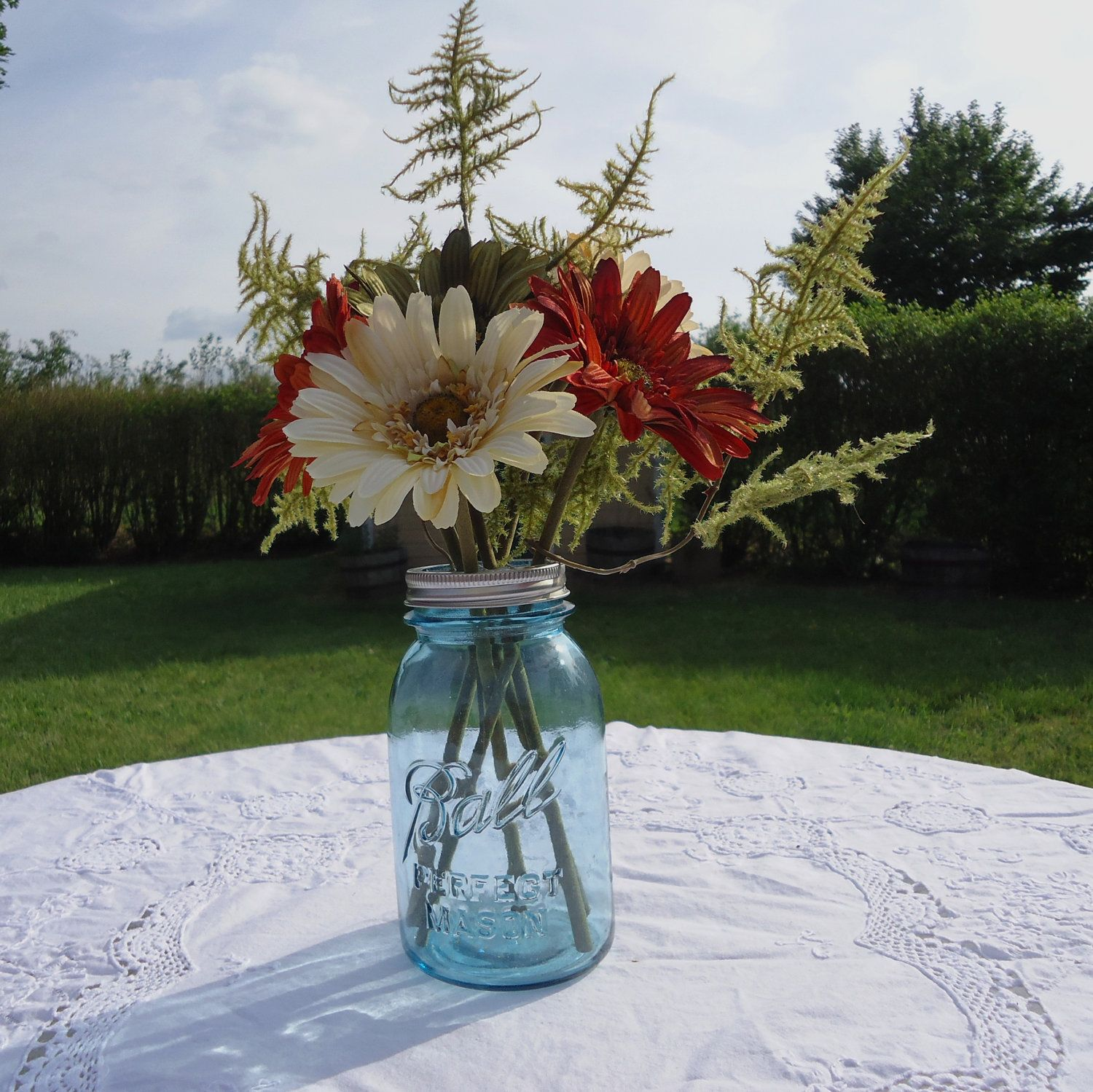 Blue mason jar with flower frog top via etsy mom and